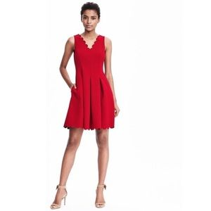 V-neck red skater dress sleeveless scalloped hem